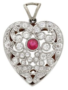 Belle Epoque Platinum, Gold, Ruby and Diamond Heart Pendant-Brooch.  One round…