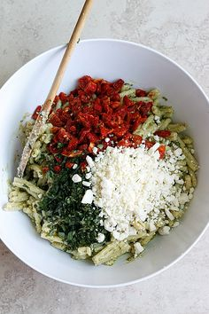 An easy, tasty, cool and creamy pesto pasta salad, that is the perfect addition to any summer meal!