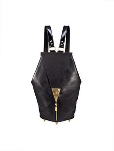 BLACK CALF LEATHER  BACKPACK  Front flap closure finished with polished brass hardware and magnetic snapfastening. Zipped front pocket. Two black patent leather shoulder straps with adjustable length.  Gold coloured metal hardware.  Characteristic brass rivets on the bottom.  One internal ...