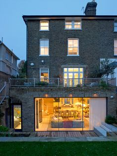 A large kitchen extension with lots of glass and a terrace above - nice!