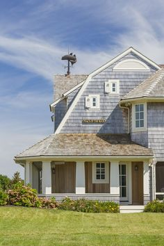 Blue-grey shingle siding looks great in this Dutch gable!