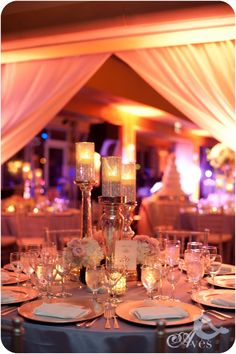 Prettiest Wedding Reception Setup with Candles and lighting. Dallas Four Seasons Weddings Aves Photography New Years Eve Wedding Ideas Bella Flora of Dallas1023