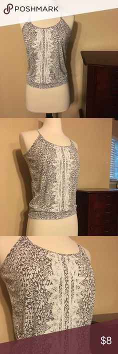 Aerie tank Adjusting tie straps in the back. Nice tribal design in center and in great condition Tops Tank Tops