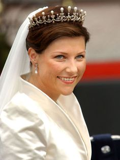 Princess Märtha Louise of Norway wearing (a replica) her great grandmother, Queen Maud's pearl and diamond tiara for her wedding in May 2002. The tiara has also been worn by Queen Sonja, and Crown Princess Mette-Marit.