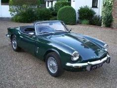 a green mg spitfire...what a shame the don't make cars like this any more!