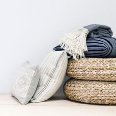 color inspiration for my living room - natural woven poufs, deep blues, and light greys. #home #grey #blue