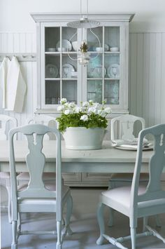 Charming white painted furniture in this country cottage.
