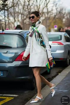 White coat, white shoes, and pop of color on handbag and scarf