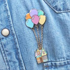 #ADVENTURERPIN It is two pins attached with a chain The balloons are detachable so if you want to hook the balloons onto another pin you can aswell! Gold Plated Hard enamel 25mm each pin Adventure is out there