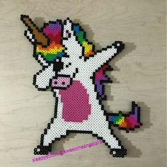 Made dabbing unicorn perler bead sprites because how could I not. Original photo was a t shirt design and it has a shadow I wasn't sure about. So I made one without the shadow as well. Which do you like better? #sleepystitchshop #unicorn #dabbing #dabbingunicorn #perler #perlerbeads #hama #hamabeads #fusebeads #meltybeads #artkal #artkalbeads #8bit #pixel #sprite #handmade #homemade #kandi #geek #nerd #fandom #dance #fad
