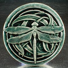 Dragonfly tile, wall tile, ceramic sculpture, 3 3/4 inches round, glossy deep blue crackle glaze
