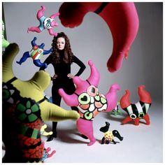 Niki de Saint-Phalle standing among her sculptures, photo Bert Stern 1968