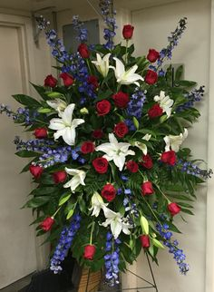 Funeral spray with Red roses, white oriental lilies and blue delphinium. Casket Flowers, Grave Flowers, Cemetery Flowers, Church Flowers, Funeral Flowers, Flower Spray, Flower Ball, Flower Pots, Funeral Floral Arrangements