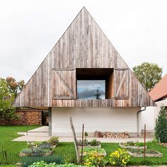 clad in natural timber planks, underneath the oversized gabled, gens architecture has designed a quaint contemporary house named 'disneyland'. read the full #architecture article on #designboom! image @ludmillacervenyphotographe