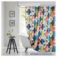 Add color and a modern update to your space with the Chance shower curtain. This unique ogee pattern features different floral and paisley patterns within each color block and spontaneous elephants.