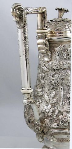 """An enormous coin silver coffee pot with the Bailey and Kitchen hallmark, pre 1848. The body has an engraved crest. Chased with repousse landscape scenes together with flowers and people. Height 13"""" to the morning glory finial. Weight: 49.75 troy ounces. Excellent crisp condition. Lacquer recently removed and needs natural tarnishing. Excellent quality chasing"""