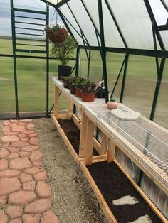 Great shelving ideas for inside your Grandio Elite Greenhouse. Photo from a happy customer in Ohio.