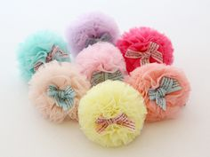 Sweetest little tulle pom pom hair clip with ribbon bow. A little bit of a statement piece and a little bit adorable.  On a 4.5cm silver ribbon covered alligator clip.  Available in 7 colours.