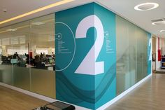 graphics wrap around multiple sides of column. Office Graphics, Window Graphics, Clinic Design, Healthcare Design, Environmental Graphic Design, Environmental Graphics, Hospital Signage, Wayfinding Signs, Glass Office