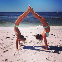 Handstand heart on the beach