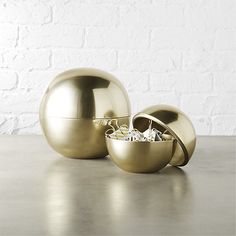 Shop dome gold storage.   Shiny things improve productivity.  True story.  Luxe orb hides paper clips, sticky notes, spare change—basically anything you want to neatly tuck away.  Also awesome as bookshelf decor and/or housewarming gift.
