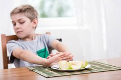 Autism and eating challenges got you down? Need tips to get a picky eater with autism and/or SPD to try new foods? We've got 8 practical tips to help!