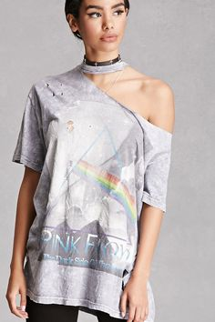 A vintage oversized band tee featuring a Pink Floyd graphic, an allover acid wash, frayed rips at the crew neck and front, and short sleeves. Each vintage item is one-of-a-kind and has a unique wash and fit.