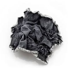 The Taiwanese artist Ying Hsun Hsu shows brooches made out of iron flakes, using magnetic power