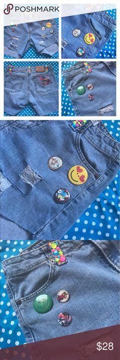 Vintage distressed denim shorts Cool buttons!!! Very cute denim shorts with distressed holes , fits size 6 ! Vintage denim Shorts Jean Shorts