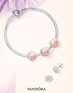 Sneak peek! Linked to grace and said to represent a bond between two people, these dahlia-inspired pieces are a fabulous and meaningful gift option. The cream enamel and blush pink crystal centres create a sophisticated interpretation of the dramatic flower. #PANDORA #PANDORAearrings #PANDORAbracelet #PANDORAcharm