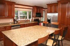 Kitchen:Beautiful Kitchen Design Idea Awesome Natural Design Of The Household Kitchen Countertops That Has Granite Table Can Be Decor With Wooden Chair Make It Seems Nice Design Inside The Modern House Design Ideas