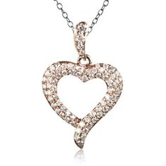 Hand-crafted heart motif pendant with clusters of very good round cut white diamonds weighing 0.33 carats pave set into 14k rose gold. The pendant's length is 2 cm. The apex of the heart extends outwards in a small flourish. A romantic gift - the Heart Beats Collection.