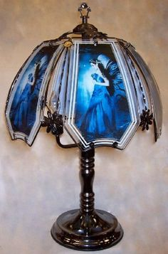 Beautiful Fairy In Blue Touch Lamp - This Beautiful Fairy In Blue Touch Lamp features delightful colors of blue enhancing this dazzling  fairy design.   Easy to care for glass panels, (Care instructions with lamp) top a great looking black chrome base.