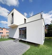 Article source: Zalewski Architecture Group Redevelopment of a small single-family house from the located in Mysłowice, Poland. The main aim of the project was to increase the usable area of the house and improve building standards and still . Different Types Of Houses, Box Houses, Poland, Garage Doors, Shed, Art Deco, Construction, Outdoor Structures, House Design
