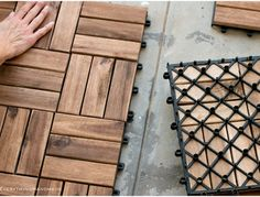 Small balcony makeover - placing the wooden tiles1