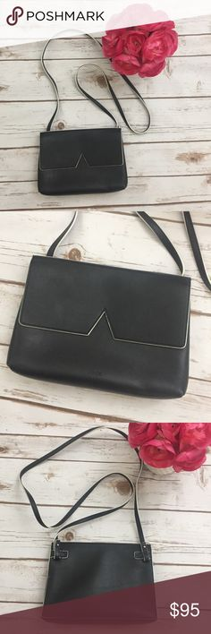 "Vince Lambskin Leather Purse Crossbody Bag Black Vince black genuine leather Crossbody bag. Very good condition as pictured. Very minor wear but no real flaws. Approximate measurements: height 6"", length 8.25"", with an approximate 23"" drop length Shoulder or Crossbody strap. ⚓No trades or holds. I negotiate only through the offer button. Any measurements listed may vary slightly however I do my best in using a soft tape measure and measure all items carefully. 🚭🐩T4 Vince Bags Crossbody…"