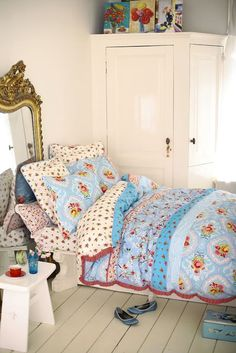 Pretty vintage bedroom decorated with wonderful, old pieces and cheerful, country cottage linens.