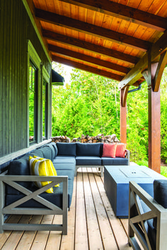 A large sectional grey sofa on the back deck is a relaxing place to sit and enjoy the day