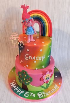 Trolls rainbow cake with edible Poppy