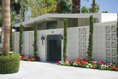 House façades are frequently shielded from the sun by distinctive open-work cement-block screen walls.