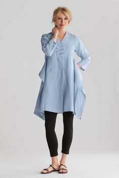Ethereal Tunic by Heydari. Both architectural and airy, this tunic is a statement piece with panache. Side darts create a shaped bodice which cascades to an open, tunic-length top. Three front ties provide a distinctive closure. Overview: An Artful Home exclusive Long sleeves Falls above the knee Artist-made in the U.S.A. Fabric linen Hand wash, line dry Fit 14) Garment measurements: Sleeve length: 20.5;; Garment length: 39;; Model is 5'10;; Shown with Matte Jersey Classic Leggings by…