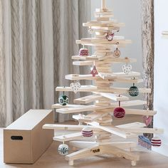 Timba Tree – Created by a Sussex-based company, each branch of this easy-to-assemble wooden tree has a tealight holder carved into it. Be inspired by Scandinavian style and add red-and-white decorations. Medium tree, £159 (timbatree.co.uk)