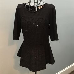 Anthropologie Black Knit Peplum Top. Black Knit Peplum Top. Keyhole button back closure. A few sequins woven within the bodice. Sleeves come to elbows. Only worn twice. Very Comfortable. Anthropologie Tops Blouses