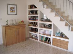 Shelves under stairs - make back wall colour as a feature