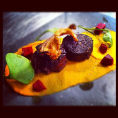 Black pudding, bacon, beetroot & carrot.