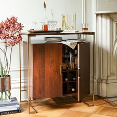 Lofted on a slender wrap-around frame, the Baron Deco Bar Cabinet is a lot of bar for not a lot of space. An interior storage grid keeps favorite wines in easy reach while a mounted rack organizes stemmed glassware.