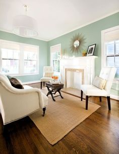 Benjamin Moore Wythe Blue, one of the best cool paint colours for a south facing and bright room. Shown in living room with oak wood flooring