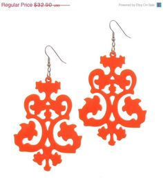 Baronyka Exclusive Victorian Lace Earrings - Elegant Jewelry - Evening Jewelry   These unique & exclusive Victorian design earrings are made from orange acrylic, they hang on NICKEL FREE Gunmetal plated over brass earwires and measure 2.5 inches tall by 1.5 inches wide (63X38 mm).  These earrings make a bold statement, yet are surprisingly lightweight and easy to wear.  All of my jewelry comes with a gift box.   $32.9