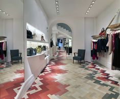 Stella McCartney's first Milan store. Multicoloured Oak Parquet Flooring - love it!