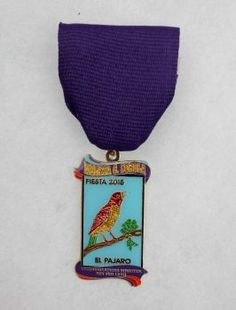 Rey Feo's communications minister Melissa Sorola's Fiesta medal pays tribute to her late grandmother, who loved playing loteria. El pajaro, or bird, is a nod to Twitter's trademark symbol. The back of the medal lists two royal hashtags, #ReyFeoJGH and #meli3409.Award: Third place, kings & courts Photo: Juanito M Garza, San Antonio Express-News / San Antonio Express-News